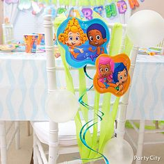 Turn your party chairs into kelp forests! Decorate by adding streamers & Bubble Guppy swirl decorations on top!