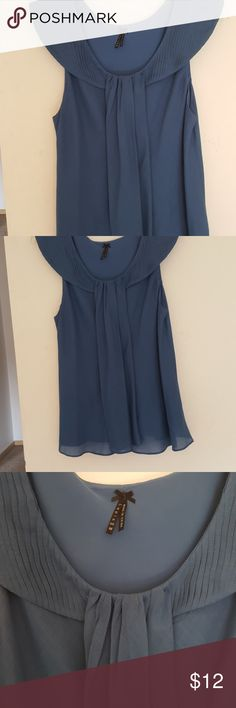Sleeveless blouse, worn once Beautiful blue sleeveless blouse,  very lightweight linen, with a liner. lapis Tops Blouses