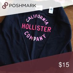 Black long sleeved sweatshirt Black long sleeved sweatshirt by Hollister with pink Graphics on front. With tags, never worn. Size small, but over sized and fits a size Large adult. Hollister Tops Sweatshirts & Hoodies
