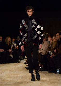 Oversize intarsia check bomber jacket, styled with slim-leg jeans and navy leather lace-up weather boots