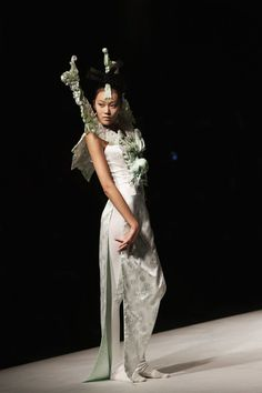 A model showcases designs on the catwalk during the XuMing Haute Couture Collection of the China Fashion Week S/S Collection 2013 at Beijing Hotel on November 1, 2012 in Beijing, China.