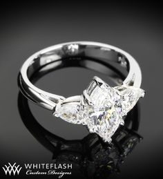 This gorgeous platinum 3 Stone Marquise Engagement Ring is set with Pear stone accents. These accents bring out the best in this beautiful Marquise diamond engagement ring.