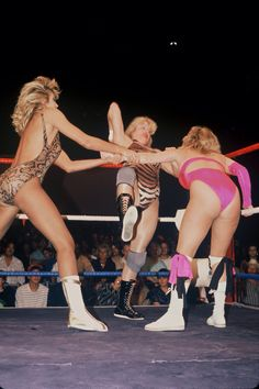 Candi Divine and Rustee Thomas double team Misty Blue Simmes in a 1991 LPWA match