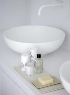 Minimal white sink.  Simple bath routine.