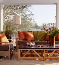 Give a screened-in porch a warm vibe by using a rich brown and orange color scheme. Find more inspiration for outdoor rooms: http://www.bhg.com/home-improvement/porch/porch/outdoor-porch-design-and-decorating/?socsrc=bhgpin100212warmcolorsporch#page=4