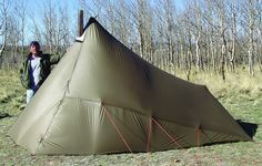 Kifaru Sawtooth teepee/tent.  Used with an ultra lightweight backpackable stove for 4 season comfort.