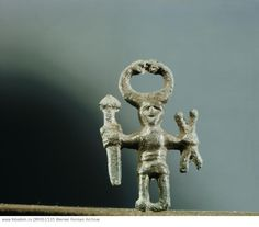 Pendant or amulet of a man holding a sword and two spears and wearing a horned helmet. Probably represents a priest of the cult of Odin. Country of Origin: Sweden. Culture: Viking. Date/Period: 9th C. Place of Origin: from a woman's grave, Uppland. Material Size: bronze. Credit Line: Werner Forman Archive/ Statens Historiska Museum, Stockholm . Location: 18.