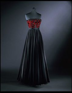 "Evening Dress, James Galanos (1924-), USA: 1959, silk-lined chiffon and velvet embroidered with bugle beads, chenille and soutache. ""James Galanos launched his own fashion label in 1951. He decided to create his very sophisticated high fashion collections in Los Angeles. For this dress, made in 1959, he paired black with just one colour. The result is highly successful."""