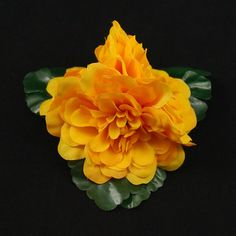 Triple Golden Hair Flower:A flower can make even the dreariest day seem cheery! You can wear them in your hair, clip them into a hair scarf, wear on your cardigan or purse. A very versatile accessory! This triple golden yellow flower is mounted on green leaf accents with a single prong hair clip. The hair flower measures approximately 5 inches. Made in the... $8.00