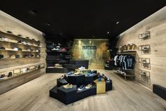 Design and morphology of the store represent an underground mine with rock and metal elements materialized through the use of black stained plywood, rude oak and brass, emphasizing the exclusive feeling.