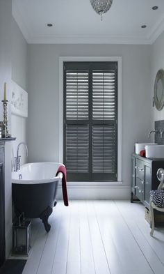 Use dark colour for features within a white room to add a subtle monochrome style to your home.
