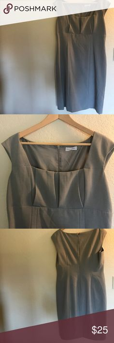 """Calvin Klein Gray Dress-Office Staple! Classic & Chic Calvin Klein Gray Dress with pintuck detail at the bust. Fully lined. Perfect for summer at the Office! Size 12 Measurements: 19"""" bust waist 18"""" hips 19.5"""" & 39"""" top to hem & Pretty cap sleeves. Zip back with small slit in the back. 🐰 EUC. Bundle & Save with my other listings including City Chic Banana Republic Old Navy J. Crew Calvin Klein Torrid Forever 21 Ann Taylor Lane Bryant Express Zara 🐰 Calvin Klein Dresses Midi"""
