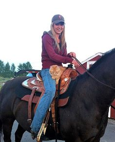 Amber Marshall riding with her cat Chevy