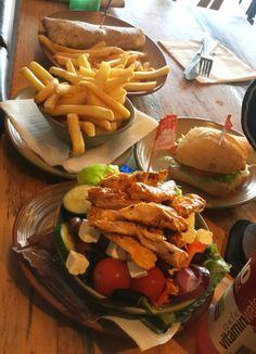 Nandos - salad, burger and fries.