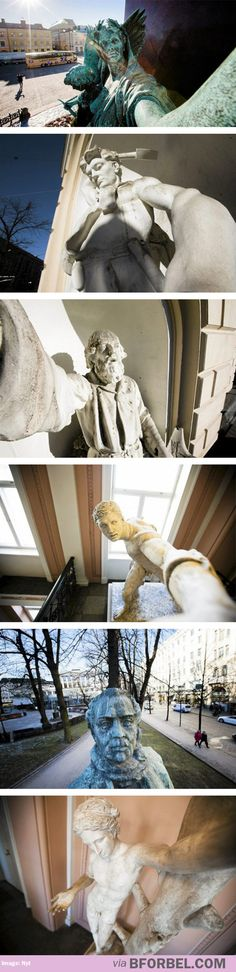 Statues that look like they're taking selfies...