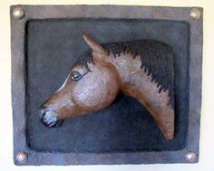 Paper pulp horse head sculpture