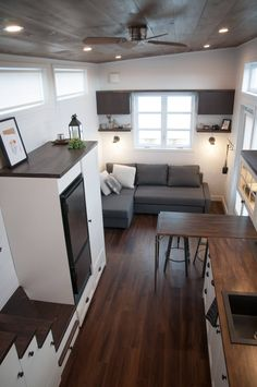 As you first enter the Laurier you'll be in the living room, which has a sectional couch that converts into a queen bed with storage underneath.