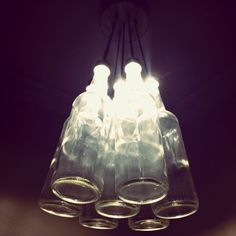 Cool light fixture made out of bottles by margery