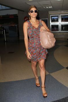 Eva Mendes Day Dress  Eva looked summer-chic in a floral-printed day dress with a blush Dior bag and tan leather wedges.  Brand: Madewell