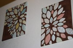 I painted canvas with one layer of brown acrylic paint. I used my silhouette to cut out petals in coordinating colors, then hot glued them on after I arranged them.