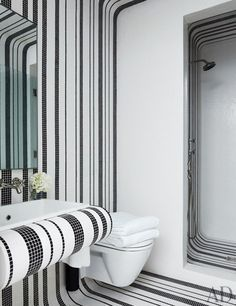 A black and white bathroom sheathed in Bisazza tile   http://archdigest.com