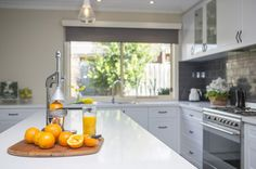 Perfect for entertaining, this country-style kitchen renovation in Mooroolbark features clever storage ideas and layers of white to brighten the space. Quality Kitchens, Kitchen Doors, Painted Doors, Kitchen Styling, The Hamptons, Kitchen Design, Satin, Home Decor, Classic