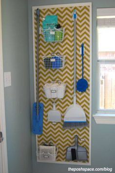 """Organize brooms and mops in the laundry room with a peg board. Love the painted chevron painted over the pegboard along with the """"frame"""". Way to class up boring pegboard! Organisation Hacks, Laundry Room Organization, Organizing Tips, Organize Cleaning Supplies, Organising, Storage Organization, Organize Room, Laundry Sorter, Laundry Storage"""
