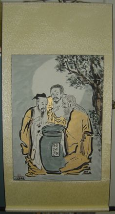 three vinegar tasters golden scroll painting. This is from a traditional Taoist story.  The Buddha tastes the vinegar and finds it bitter. Confucious tastes it and finds it sour. Lao Tzu tastes it and smiles because he's had the chance to taste it.