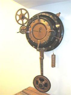 Clock Work Punk Clock : A Steampunk wall clock in its full glory!  Solid metal vintage gears and wood pattern.