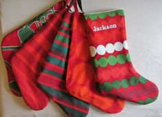 A set of 2 Marimekko personalized stockings,  Christmas stockings, emboidered name, choose the fabric, Finland. $58.00, via Etsy.