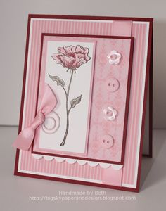 handmade card ... monochromatic pink ... buttons ... bow ... patterned paper ... blossom image ... lovely!