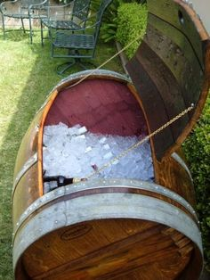 Wine Barrel Ice Chest….while I was looking at this…it could also become a great storage for outside toys and gardening utensils… :)