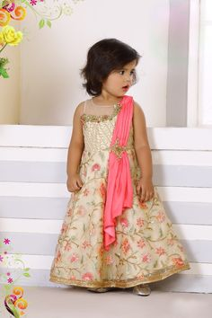 Palkhi fashion exclusive beige colored girls designer suit for girls.Outfit highlighted with petite stone & multi colored embroidery work.It comes attached pink dupatta. Party Wear Frocks, Kids Party Wear Dresses, Kids Dress Wear, Kids Gown, Gowns For Girls, Dresses Kids Girl, Kids Outfits Girls, Girl Outfits, Indian Dresses Online