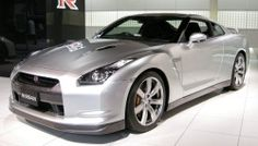 The production version of the GT-R debuted at the 2007 Tokyo Motor Show, launching in the Japanese market on December 6, 2007. The large disparity in initial marketing between these regional releases is due to Nissan having to build GT-R performance centers where the car is serviced. Also the engine and rear-mounted dual-clutch gearbox are built by hand, thus limiting production to around 1000 cars a month.