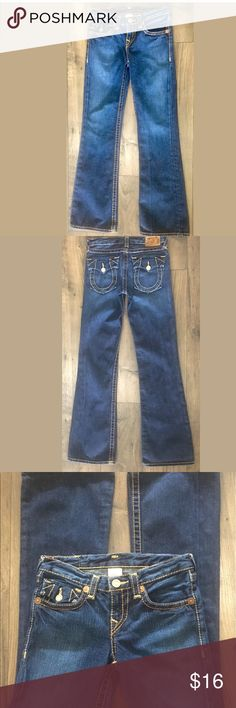 """Girls True Religion World Tour Jeans, Size 14 True Religion Jeans World Tour Flare Leg, dark wash Denim, jeans, size 14 5 pocket style, back pockets are flap 100% cotton MSRP: $159 Measurements taken laying flat Waist: 26"""" Inseam: 31"""" Front rise: 8"""" Arrives clean and ready to wear, good condition with no stains or holes from a smoke free environment True Religion Bottoms Jeans"""