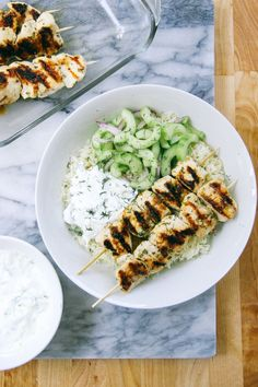 Grilled Chicken Kebab Bowls with Cucumber salad and Tzatziki made with Greek Yogurt.