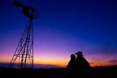 A couple at dusk during their engagement photo session near Rockford, IL    www.ryandavisphotography.com