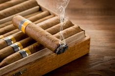 An expensive cigar doesn't always mean that it tastes better. The truth is that you can find great cigars at any price point. Here's 10 good cheap cigars. Cigars For Sale, Cheap Cigars, Cigar Party Theme, Cuban Cigar Brands, Cigar Quotes, Best Cigar Humidor, Cigar Art, Premium Cigars, Good Cigars
