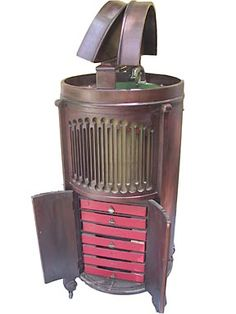 The Modernola  Johnstown,Pennsylvania.  Trademarked 1918. Trademark refiled 1923.    These circular machines have been seen in walnut, mahogany and Chinese Chippendale finishes. Tabletop Modernolas have been reported.  The Modernola Company turns up in the Johnstown business directory as late as 1923.  Like many other struggling phonograph companies in the 1920s Modernola also began to offer radios.