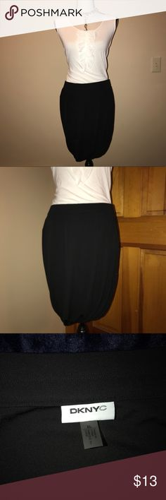 DKNYC Black Pull On Tulip Skirt DKNYC Black Pull On Tulip Skirt size XL The pictures don't do it justice.  It looks 1,000x better on...and on anyone who doesn't have my pasty white legs right now.  Nice heavy weight provides a beautiful drape.  Very comfortable and easy to move in due to the slight stretch and pull on styling. DKNYC Skirts