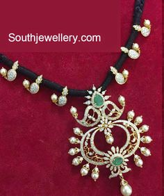 Black dori necklace featuring mango motifs and chandbali pendant adorned with diamonds, emeralds and south sea pearls from Aabharanam Jewellers. Gold Earrings Designs, Gold Jewellery Design, Bead Jewellery, Beaded Jewelry, Gold Designs, Jewelry Necklaces, Indian Wedding Jewelry, Indian Jewelry, Bridal Jewelry