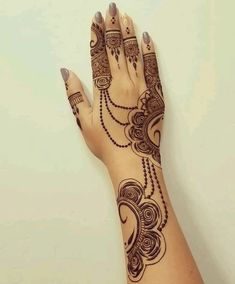 Fascinating new year mehndi designs for hands and arms are just perfect for enhancing your beautiful appearance and personality. Hardly, there would be any woman who has not applied mehndi on her and arms. Traditional Mehndi Designs, Indian Henna Designs, Stylish Mehndi Designs, Mehndi Designs For Fingers, Beautiful Mehndi Design, Latest Mehndi Designs, Bridal Mehndi Designs, Simple Mehndi Designs, Traditional Tattoos