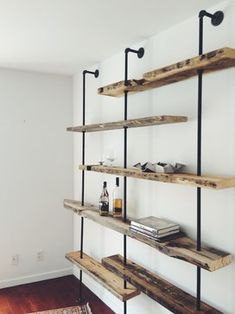 Adjustable Rustic Modern Shelving Unit of Reclaimed Wood - rustic - Wall Shelves - New York - Coil + Drift