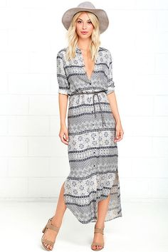 Whether you're cruising through the desert or headed to the office, the White Crow Red River Navy Blue Print Shirt Dress will fit right in! This cute collared dress features an allover navy blue, cream, and taupe print, composed of woven rayon. Full, front button placket travels to a rounded, slight high-low hem with side slits. Fun, braided faux leather belt accent with beads.