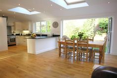 A beautiful kitchen/diner extension, with pine roof windows will add light and space to your home. We recommend safety glazing for high up installations, such as home or kitchen extensions. Image via Spicer McColl. Open Plan Kitchen Diner, Kitchen Diner Extension, Open Plan Kitchen Living Room, Kitchen Family Rooms, New Kitchen, Kitchen Ideas, Kitchen Extension With Skylights, Open Living Rooms, Island Kitchen