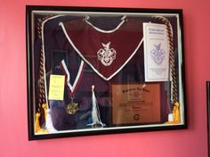 Add in graduation cap and gown, diploma, cords, tassels, tickets and everything else in a shadow box.
