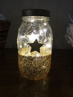 Mod podge, glitter, and fairy lights...custom centerpiece for twinkle twinkle little star shower