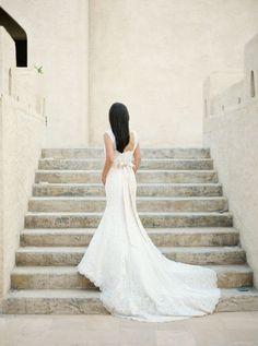 elegant lace wedding dress with an ivory sash