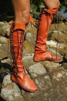 Brighten up your wardrobe this season with these glorious orange leather boots designed to make you feel fabulous. Walk the high street in these bohemian style leather boots whilst turning heads, as you look sexy, confident and stylish. And with the added brown lacing you can tie them in any way you choose.