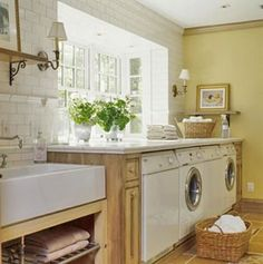 counter over washer and dryer, fresh flowers, big window, big sink